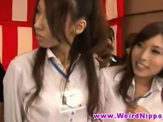 Japanese babes in bizarre show rip clothes off each others body