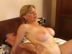 A gorgeous blonde mature takes a hard cock deep in her ass