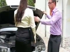 hot brunette fucks in clothes on car
