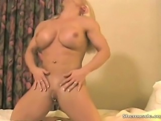 Melissa Dettwiller again strips down to shows off her huge pecs, then rips off her panties to show her amazing...well, you'll see! This blond amazon has one hot smoking body...