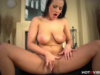 Soft skinned and flirty MILF, Carmen Croft, tickles and jiggles her amazing jugs whilst masturbating with the powerful HotGVibe.