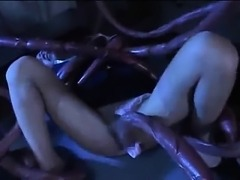 Hot asian girl is fucked by big tentacle on table