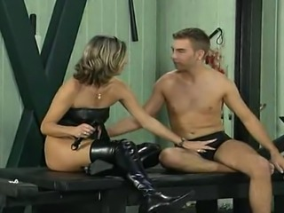 A hot dominatrix demands a good seeing-to from her young client