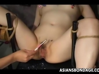 Japanese slave slut gets her wet pussy teased