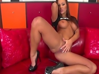 Brunette pornstar Shayla Green fills her shaved pussy with her big dildo and...