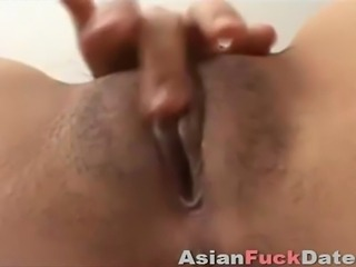 Skinny Asian babe masturbating on camera