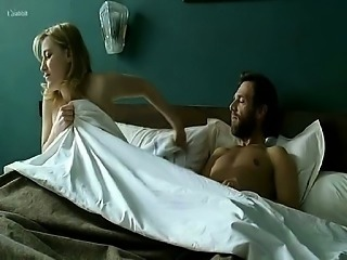 Valeria Bruni Tedeschi nude on bed while a guy has sex with