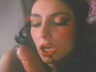 Marlene Willoughby. a Penthouse Pet from the 1980s, takes a bearded dude into a room full of lit candles and fucks his brains out.