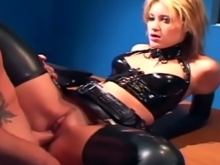 Petite blonde in a cop uniform and shiny latex lingerie fucking on a desk