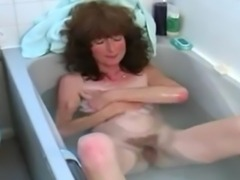Hairy brunette masturbating in bathtub, she play with her nice hairy pussy