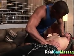 Muscly masseur gets hard