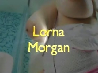 Lorna with her tits out preparing a bath