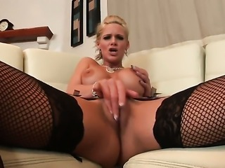 Phoenix Marie with big boobs and smooth cunt shows it all as she plays with her slit