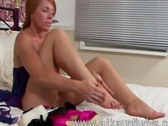 Mature redhead Kay C tries on some lingerie, then she tries it off and...