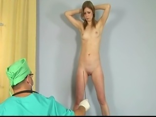 Horny gynecologist offers a lot of very special procedures to this redhead babe during gyno exam