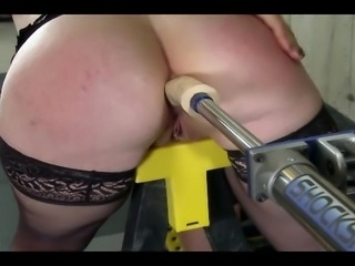 A FemDom plays with Her lesbian slave.