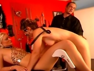 Two attractive slave girls getting tied up and tortured by a master