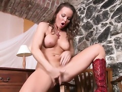 Silvia Saint has fire in her eyes as she plays with herself