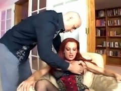 Busty redhead fucking in black seamed stockings and stiletto high heels