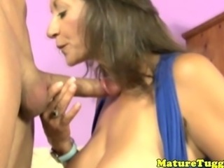 Busty MILF mature jerking a cock off like a pro