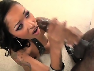 Exotic beauty sucking uncut black dick