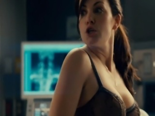 Erica Durance straddling a guy on a hospital bed and pulling her shirt off to show some nice cleavage in a bra. From Saving Hope.