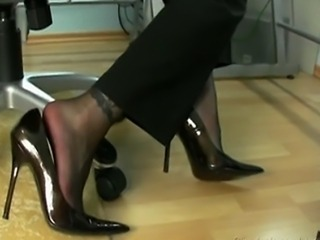 woman in block stockings is giving a footjob in black stockings and gets a cumshot in her high heels and puts them on