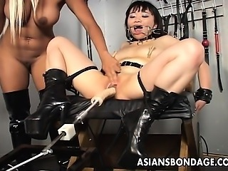 Blonde mistress toys her Asian slavegirl into submission