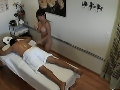 Sexy Asian girl with plump tits and delicious ass presents an exciting massage