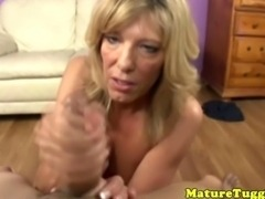 MILF tugjob lover toying with a cock