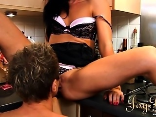 Hot brunette doll gets eaten on the kitchen table
