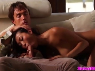Lustful asian babe surrenders to passion as she gives head