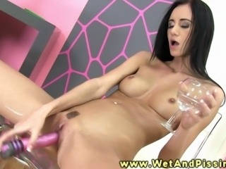 Pissdrinking babe dildofucks herself after quenching her thirst