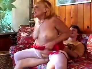 Horny grandmother wearing white stockings, sucks and fucks her grandson hard cock. She loves his young cock and loves the facial she gets at the end of hot sex.