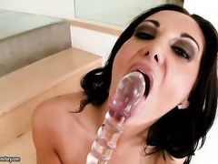 Brunette Ava Addams does striptease before she sticks sex toy in her pussy hole