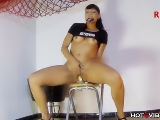 Slender Spanish MILF, Lara Tinelli, sticks her favorite Hotgvibe covered dildo to a chair and fucks it until it makes her squirt.