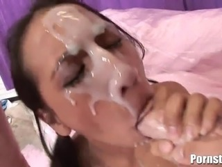 This petite but extremely cock-hungry brunette porn chick Amia Moretti gets both her tight pussy and her mouth penetrated by three giant cocks and gave her some of the messiest facial loads ever.