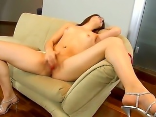 Sweet Isabel loves the satisfying sensation of her trembling shaved pussy as she fingers it wildly