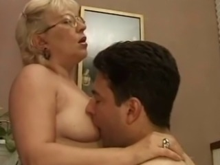 Well aged babe in glasses gets her pussy and asshole penetrated by a young sex-hungry cock