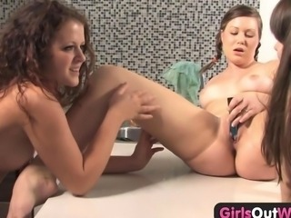 Young lesbian threesome in the kitchen is hot