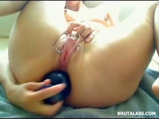 Horny lady pushes apples and different huge dildos in her asshole until she prolapses hard!