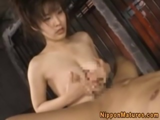 Asian milf sucks and titfucks dudes dick and shows all to the camera