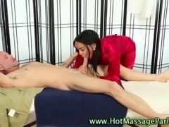 Brunette masseuse in heels sucks and tugs clients cock