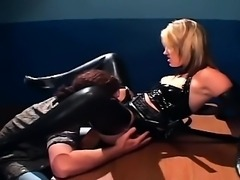 Blonde in a uniform and latex lingerie fucking