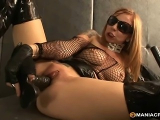 Sexy redhead in black latex using huge dildo to satisfy her burning pussy