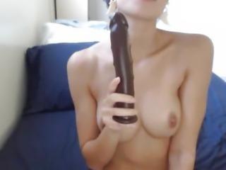 Hot Busty Babe Licks a Dildo