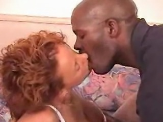 This redhead hottie is into black men. Watch her compilation of kissing scenes with many of the black men she has been with.