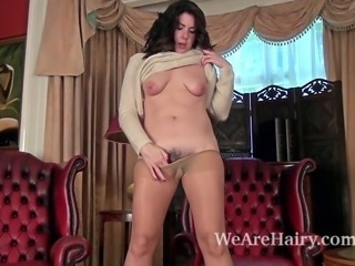 Hairy woman Sharlyn enjoys sitting in her lover's favorite room. She decides to make a video. She slowly strips off her stockings and begins to masturbate her pussy in a huge leather armchair.