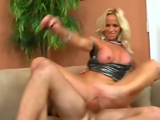 Turned on arousing and tempting blonde cougar with big firm hooters and long...
