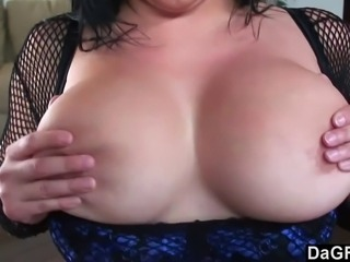 This hot slut is named Sonya Sage and you can tell with all the fishnets she is wearing that she is dressed to fuck. Her man comes in and sticks his dick between her breasts. After a while he flips her on her back for a good dicking and then jizzes on her boobs.